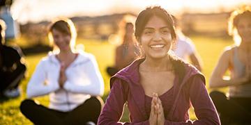 women practise yoga
