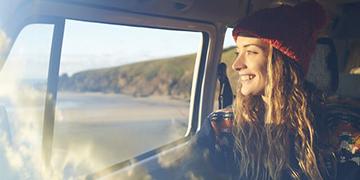 women in car smiling